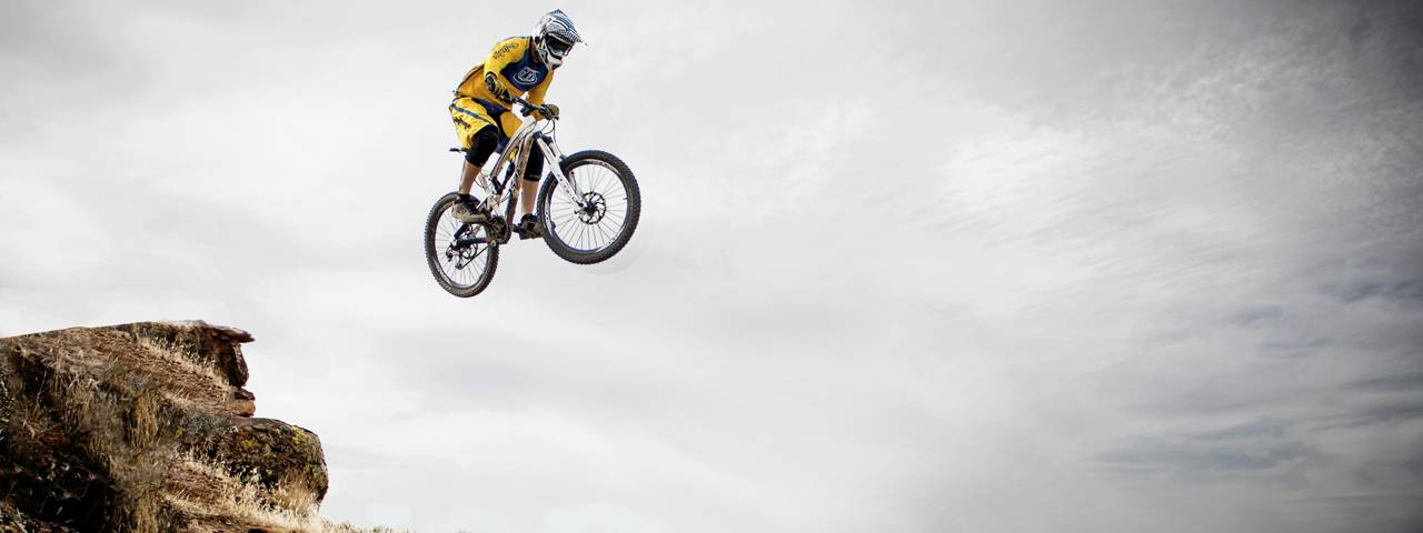 sports downhill biker jumping small
